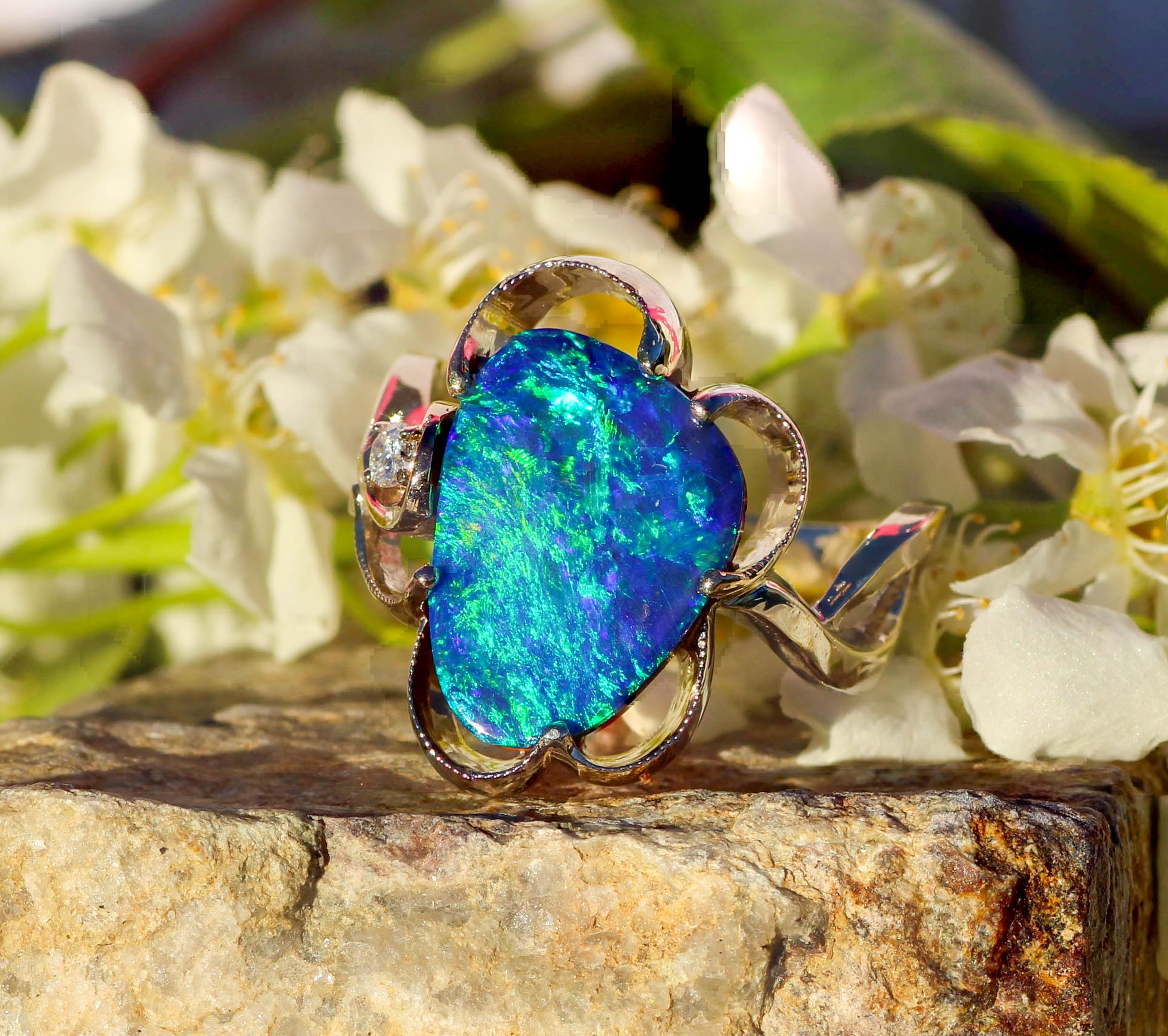 Opal and Diamond ring in 14kt white gold