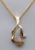 Opal and Diamond Pendant in 14kt white gold