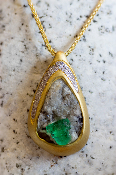 Stunning Emerald crystals and Diamond pendant in 14Kt yellow gold