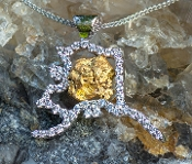 Alaska Pendant in 14kt White Gold with Diamonds and a gold nugget.