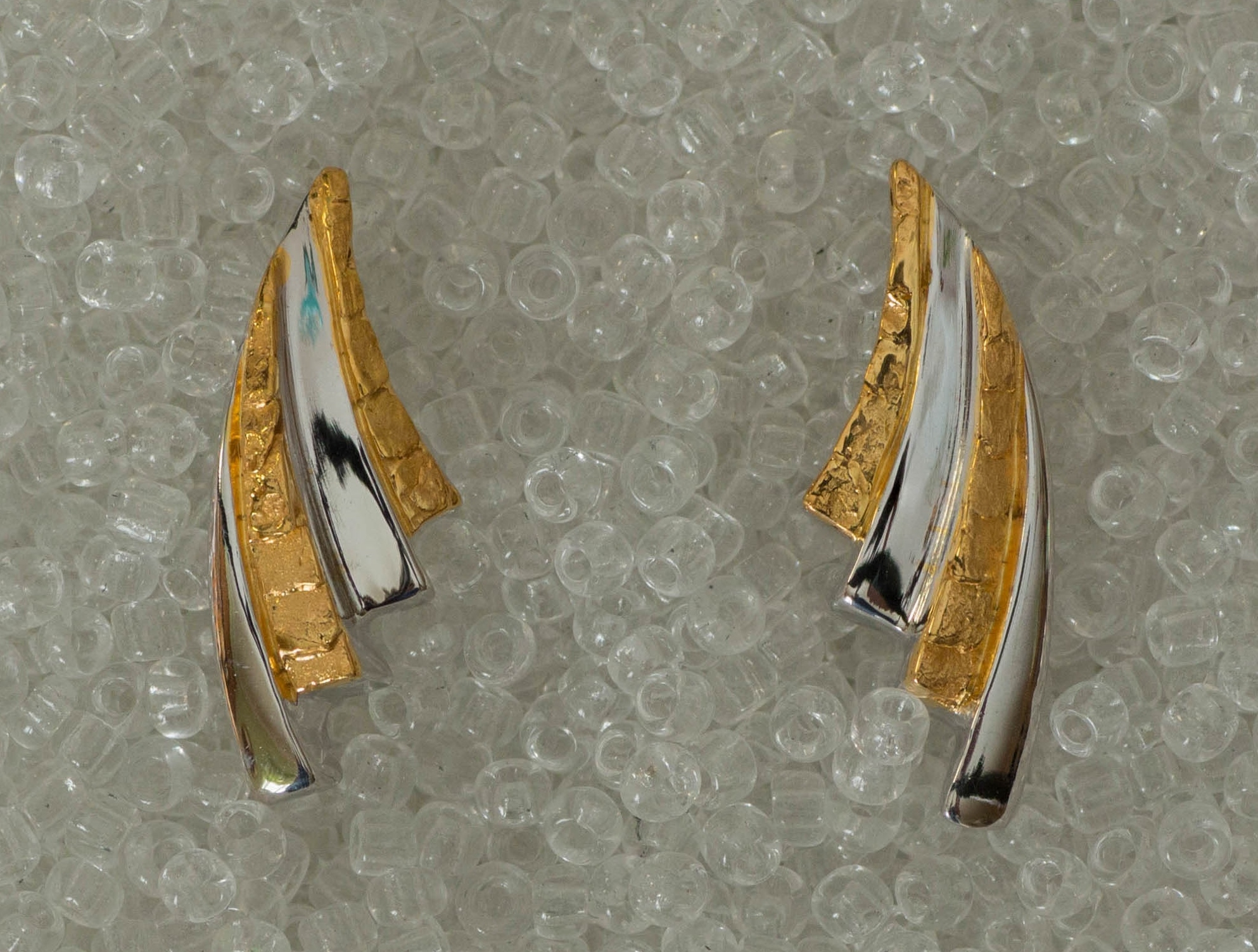 Gorgeous Alaskan Gold Nuggets arranged in swirling fan earrings of vibrant 14kt White Gold.