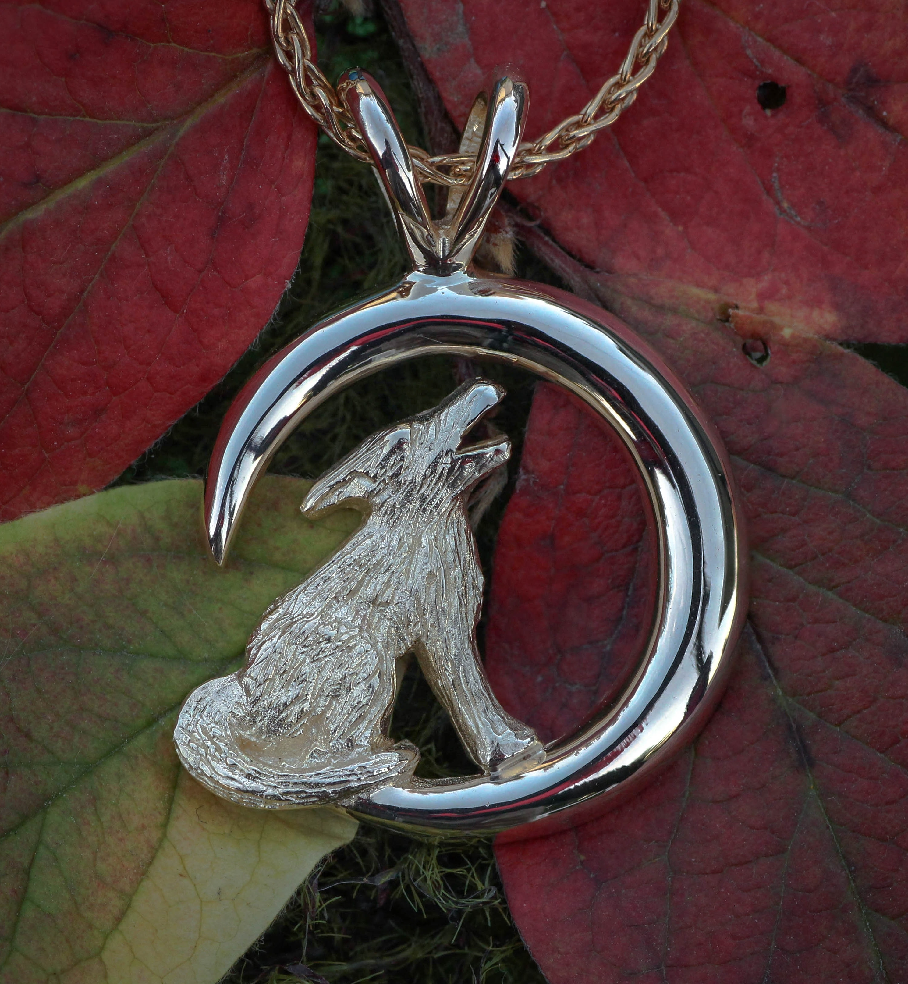Wild Alaska Howling Wolf Pendant Crafted in 14kt White Gold.