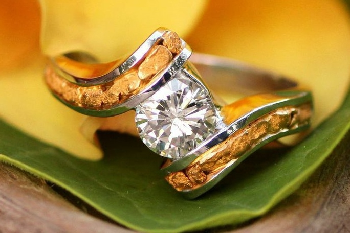 Stunning diamond center stone surrounded with gorgeous Alaskan gold nuggets fancily arranged in 14kt white gold.