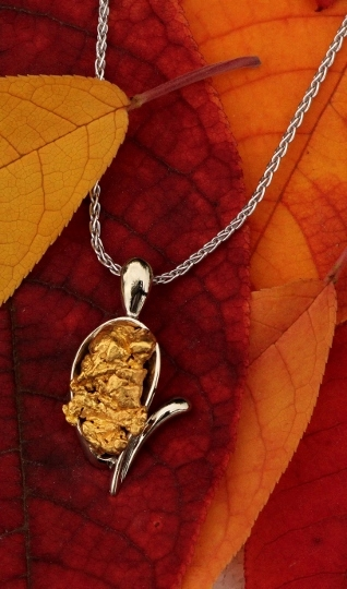 14Kt white gold pendant with natural Alaskan gold nugget.