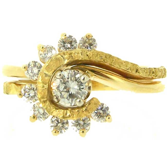 Outstanding Diamond center stone fancily surrounded with 9 spiraling Diamonds and Alaskan Gold Nuggets in 14kt Yellow Gold.